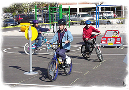 Children riding in bicycle safety class
