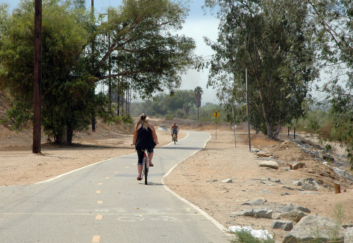 woman riding bicyle on santa ana river trail