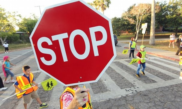 crossing guard holding stop sign
