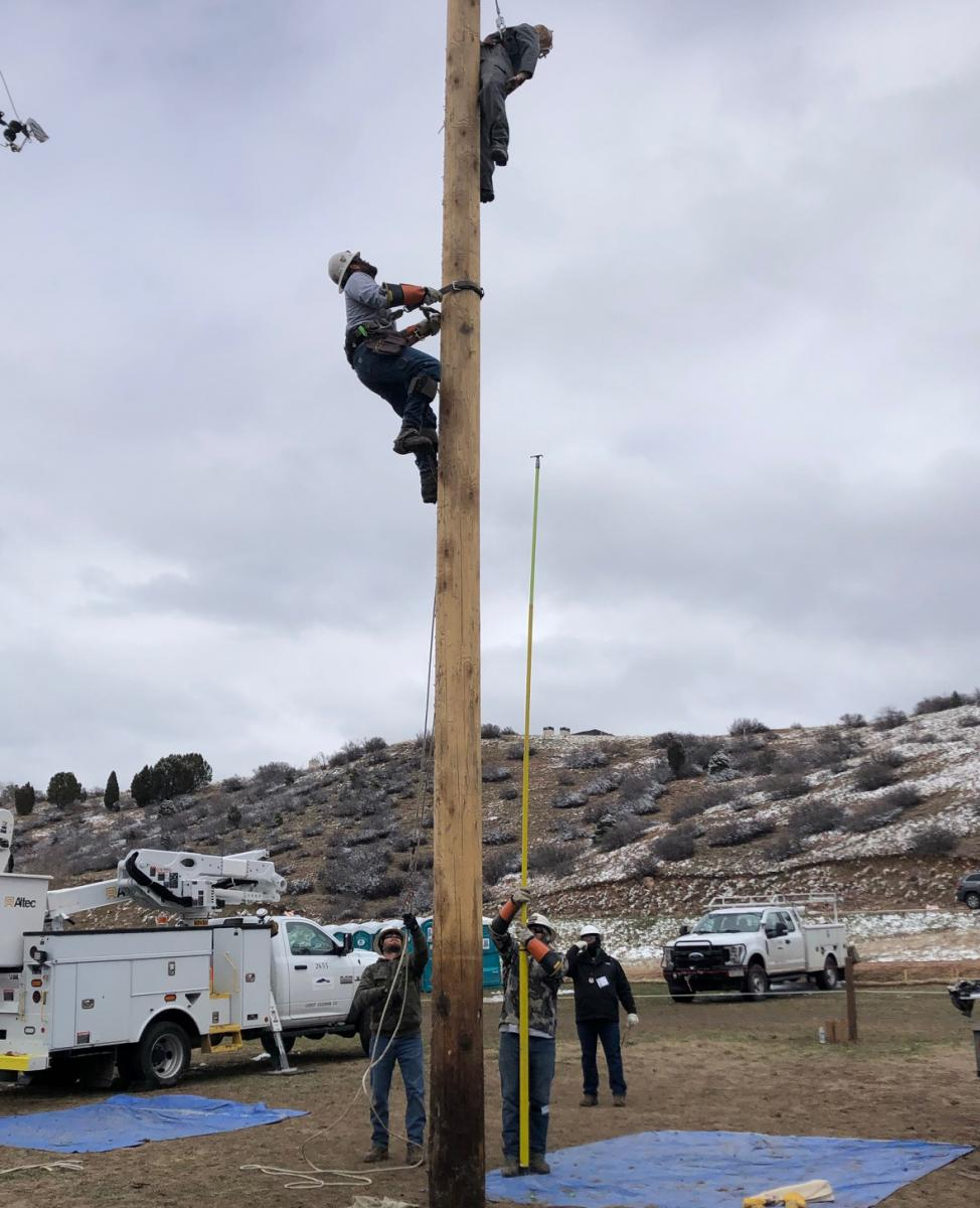 linemen compete during rodeo event